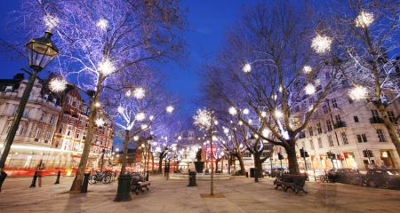 Christmas Lights Display on Sloane Square in Chelsea, London  The modern colorful Christmas lights attract and encourage people to the street