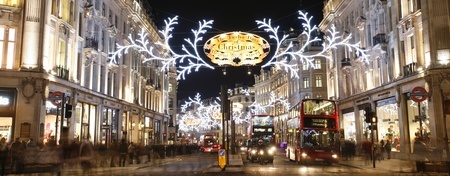 regent: London, UK - November 23, 2012: Christmas Lights Display on Regent Street in London. The modern colourful Christmas lights attract and encourage people to the street.