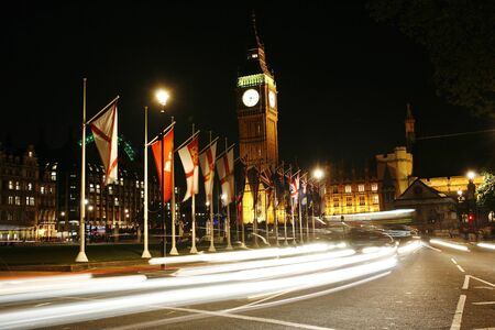 parliament square: Big Ben and International Flags, seen from Parliament Square, at Night