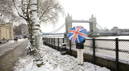 river scape: London cityscape, including tower bridge, on a snowy day   Stock Photo