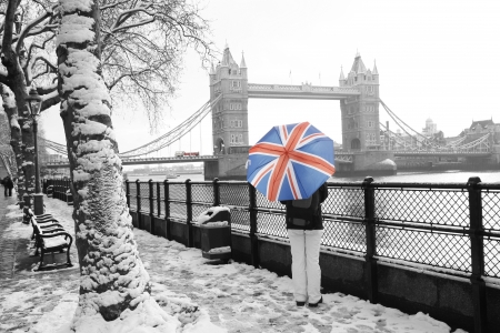 London cityscape, including tower bridge, on a snowy day   Stock Photo