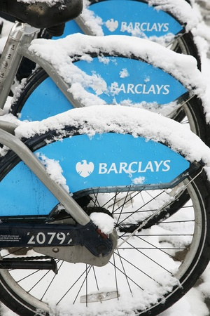 London, UK - January 21, 2013 : London's bicycle sharing scheme, to help ease traffic congestion, sponsored by Barclays, was launched on 30 July 2010. Currently there are some 6,000 bikes and 400 docking stations in London.   Stock Photo - 17712692