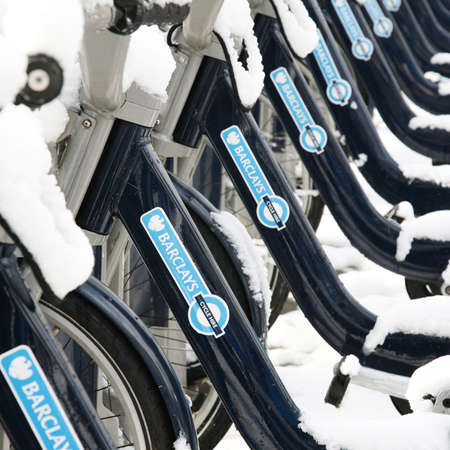 boris: London, UK - January 21, 2013 : Londons bicycle sharing scheme, to help ease traffic congestion, sponsored by Barclays, was launched on 30 July 2010. Currently there are some 6,000 bikes and 400 docking stations in London.   Editorial
