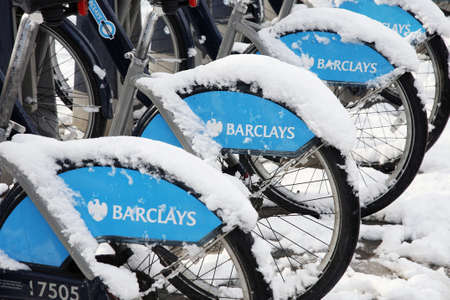 at ease: London, UK - January 21, 2013 : Londons bicycle sharing scheme, to help ease traffic congestion, sponsored by Barclays, was launched on 30 July 2010. Currently there are some 6,000 bikes and 400 docking stations in London.   Editorial
