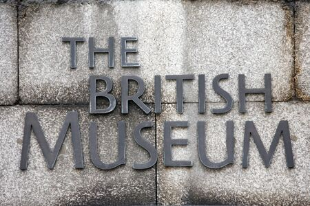 comprise: London, UK - February 7, 2013: British Museum sign on the main gate. British Museum is one of the largest, oldest museum in the world and its collections comprise 8 million items, dedicated to human history and culture, from all continents.