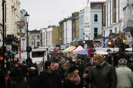London, UK - February 16, 2013: Saturday view of Portobello Market, crowd present, in Notting Hill district, largest antiques market in the UK, famous tourist attractions. The Market area is about 940 m long.  Stock Photo - 18331318