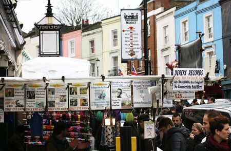 chelsea market: London, UK - February 16, 2013: Saturday view of Portobello Market, crowd present, in Notting Hill district, largest antiques market in the UK, famous tourist attractions. The Market area is about 940 m long.