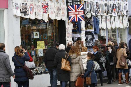 London, UK - February 16, 2013: Saturday view of Portobello Market, crowd present, in Notting Hill district, largest antiques market in the UK, famous tourist attractions. The Market area is about 940 m long.  Stock Photo - 18331282