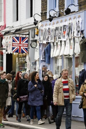 London, UK - February 16, 2013: Saturday view of Portobello Market, crowd present, in Notting Hill district, largest antiques market in the UK, famous tourist attractions. The Market area is about 940 m long.  Stock Photo - 18331324
