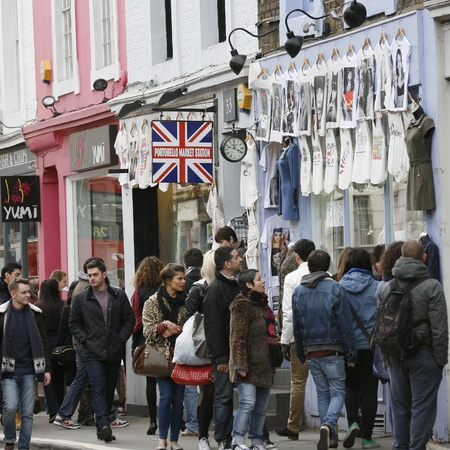 London, UK - February 16, 2013: Saturday view of Portobello Market, crowd present, in Notting Hill district, largest antiques market in the UK, famous tourist attractions. The Market area is about 940 m long.  Stock Photo - 18331275