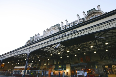 exits: London, UK - November 18, 2012: Outside view of Victoria Station, located in Belgravia, since 1860, second busiest railway terminus after Waterloo in UK, with over 73 million passenger entries and exits between April 2010 and March 2011.