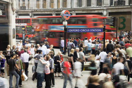 LONDON - AUG 2 : Crowd passing oxford circus on Aug 2, 2010, London, UK. Oxford Circus, busy intersection with Regent Street, is the biggest shopping street in Europe, visited by millions of tourists
