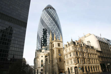 30 st mary axe: London , UK - March 25, 2012: Outside view of 30 St Mary Axe, also called Gherkin, a skyscraper in the City of London, 180 metres height, 41 floors, completed in 2003, seen from pedestrian walk path.