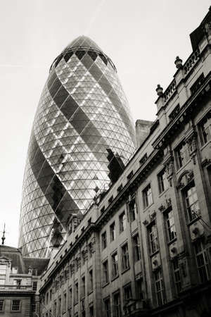 London , UK - March 25, 2012: Outside view of 30 St Mary Axe, also called Gherkin, a skyscraper in the City of London, 180 metres height, 41 floors, completed in 2003, seen from pedestrian walk path.   Stock Photo - 18560032