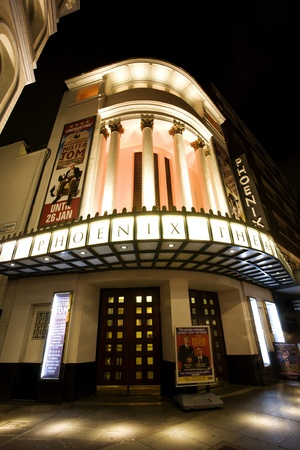 westend show: London , UK - December 10, 2012: Outside view of Phoenix Theatre, West End theatre, located on Charing Cross Road, Camden of London, since 1930, designed by Giles Gilbert Scott, Bertie Crewe and Cecil Massey, at Night.   Editorial