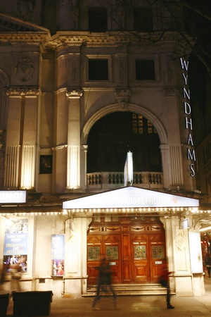westend show: London , UK - December 11, 2012: Outside view of Wyndhams Theatre, West End theatre, located on Charing Cross Road, City of Westminster, since 1899, designed by W.G.R. Sprague, at Night.   Editorial