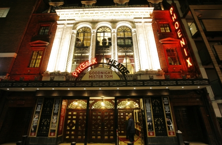westend: London , UK - December 11, 2012: Outside view of Phoenix Theatre, West End theatre, located on Charing Cross Road, Camden of London, since 1930, designed by Giles Gilbert Scott, Bertie Crewe and Cecil Massey, at Night.