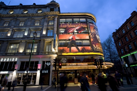 westend show: London , UK - December 10, 2012: Outside view of Queens Theatre, West End theatre, located on Shaftesbury Avenue, City of Westminster, since 1907, designed by W.G.R. Sprague, at Night.