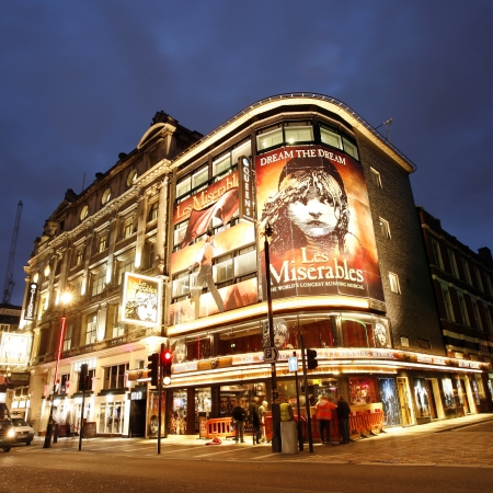 London , UK - December 10, 2012: Outside view of Queen's Theatre, West End theatre, located on Shaftesbury Avenue, City of Westminster, since 1907, designed by W.G.R. Sprague, at Night.   Editorial