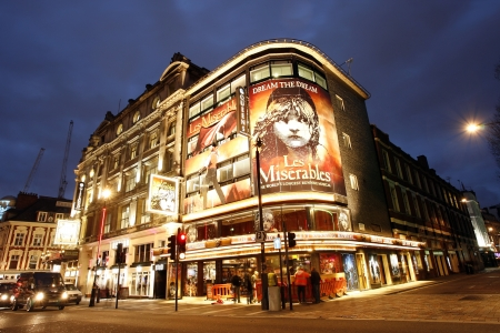 les: London , UK - December 10, 2012: Outside view of Queens Theatre, West End theatre, located on Shaftesbury Avenue, City of Westminster, since 1907, designed by W.G.R. Sprague, at Night.
