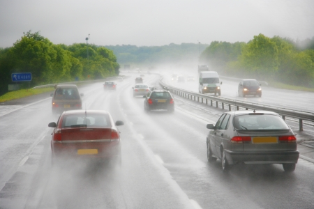 Seeing as there s heavy shower on a highway and road condition looks quite dangerous