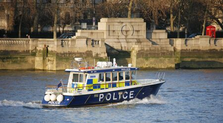 police unit: London, UK - March 5, 2013: The MPU, Marine Policing Unit , is responsible for policing of the River Thames in London, also support to Metropolitan Police and City of London Police over incidents in any waterway in London.  Editorial