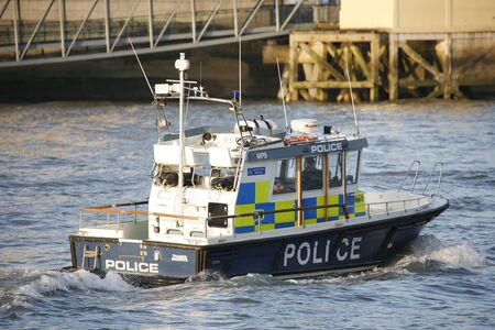 policing: London, UK - March 5, 2013: The MPU, Marine Policing Unit , is responsible for policing of the River Thames in London, also support to Metropolitan Police and City of London Police over incidents in any waterway in London.  Editorial