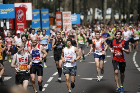 majors: London, UK - April 21, 2013: Runners in London Marathon. The London Marathon is next to New York, Berlin, Chicago and Boston to the World Marathon Majors, the Champions League in the marathon. crowds,