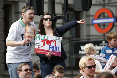 majors: London, UK - April 21, 2013: Supporters watch and cheer thousands of marathon runners. The London Marathon is next to New York, Berlin, Chicago and Boston to the World Marathon Majors, the Champions League in the marathon