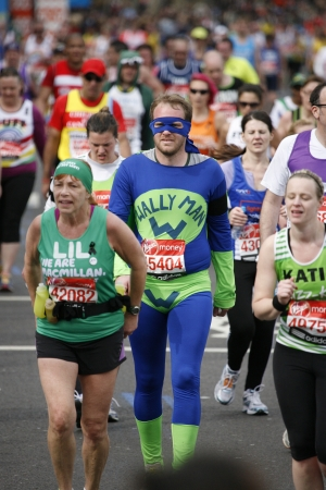 majors: London, UK - April 21, 2013: Participant in the London Marathon wearing funny costume. The London Marathon is next to New York, Berlin, Chicago and Boston to the World Marathon Majors, the Champions League in the marathon.