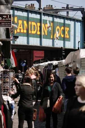 London, UK - April 20, 2013: Street view of Camden Market, crowds present, in Camden Town, also called Camden Lock. The Market is one of the most popular attraction in London attracting about 100,000 visitors each weekend.