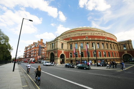 boris: London, UK - May 26, 2013 : Tourists on rental bike passing by Royal Albert Hall, public Transport, bus, taxi, presnet. Londons bicycle sharing scheme, to help ease traffic congestion, sponsored by Barclays, was launched on 30 July 2010. Currently there  Editorial