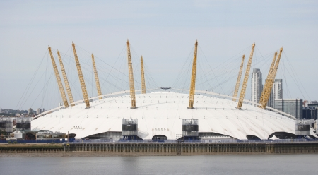 dome type: London , UK - May 26, 2013:  The Millennium Dome, also called O2 Arena, in the distance across the river Thames. The Dome, completed in 1999 by archetect Richard Rogers, is the largest of its type in the world.