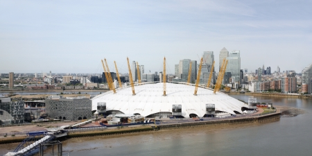 o2: London , UK - May 26, 2013:  London Skyline, seen from the Emirates Air Line cable car, inclouding O2 Arena, Canary Wharf, across the River Thames in London.