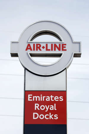 greenwich: London , UK - May 26, 2013:  Sign of Emirate Air Line, cable car system, opened June 2012, run by TFL, links the Greenwich Peninsula with Royal Dock, 1km, across the River Thames.   Editorial