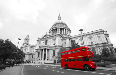 London's iconic Routemaster Bus and St Paul's Cathedral is in the background.