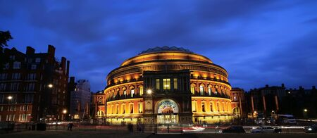 annual events: London, UK - July 14, 2013: Outside view of Royal Albert Hall at night during the BBC Proms. The Proms is an annual events, summer season daily orchestral classical music concerts take place in the Royal Albert Hall for 8 weeks.    Editorial