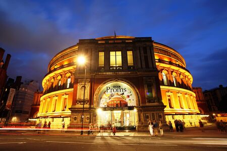 London, UK - July 14, 2013: Outside view of Royal Albert Hall at night during the BBC Proms. The Proms is an annual events, summer season daily orchestral classical music concerts take place in the Royal Albert Hall for 8 weeks.    Editorial