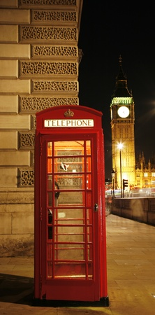 phone booth: Red Telephone Booth at night, Big Ben in distance. Red phone booth is one of the most famous London icons.  Stock Photo