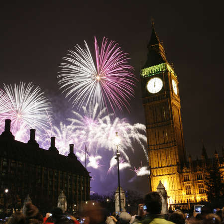 LONDON, UK - JANUARY 01, 2013: Fireworks over Big Ben at midnight, in Westminster, one of Londons main tourist attractions, be seen from the Parliament Square.