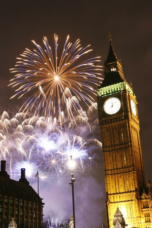 tourist attractions: LONDON, UK - JANUARY 01, 2013: Fireworks over Big Ben at midnight, in Westminster, one of Londons main tourist attractions, be seen from the Parliament Square.  Editorial