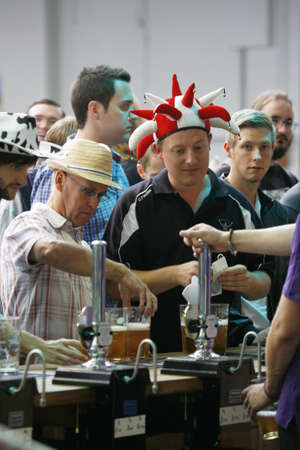 campaign for real ale: London, UK - August 17, 2013: Visitors of Great British Beer Festival, 2013, people present, at Kensington Olympia, Britains biggest beer festival. Visitors can try wide range of real ales, ciders, perries and international beers.   Editorial