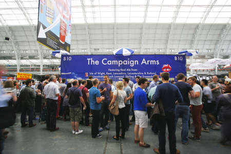 campaign for real ale: London, UK - August 17, 2013: The Great British Beer Festival, 2013, people present, at Kensington Olympia, Britains biggest beer festival. Visitors can try wide range of real ales, ciders, perries and international beers.   Editorial