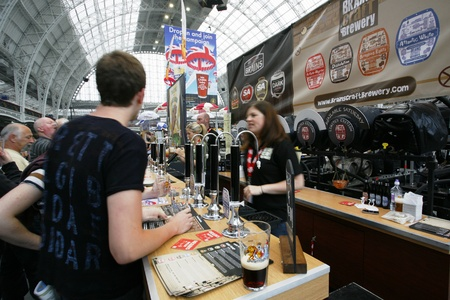 real ale: London, UK - August 17, 2013: The Great British Beer Festival, 2013, people present, at Kensington Olympia, Britains biggest beer festival. Visitors can try wide range of real ales, ciders, perries and international beers.   Editorial