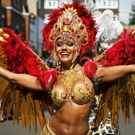 annual events: London, UK - August 26, 2013: Performers take part in the second day of Notting Hill Carnival, largest in Europe. Carnival takes place over two days in every August.