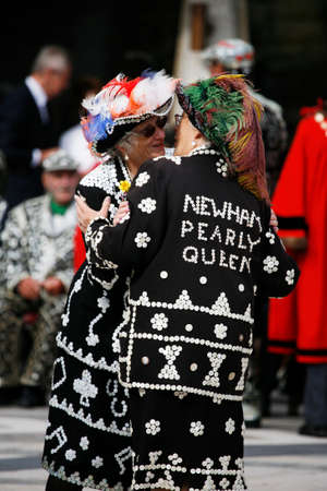 London, UK - September 29, 2013: Participants at 2013 Pearly Kings and Queens, wearing clothes decorated with commonly called pearl, charitable tradition of working class culture, Harvest Festival.