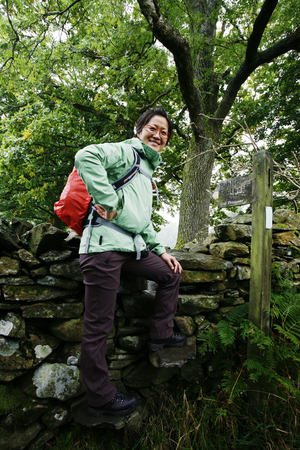 Smiling East Asian Woman hiking in Lake District, Cumbria, UK. Stock Photo - 24054113