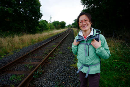 Smiling East Asian Woman hiking in Lake District, Cumbria, UK. Stock Photo - 24048333