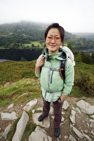 Smiling East Asian Woman hiking in Lake District, Cumbria, UK. Stock Photo - 24054128
