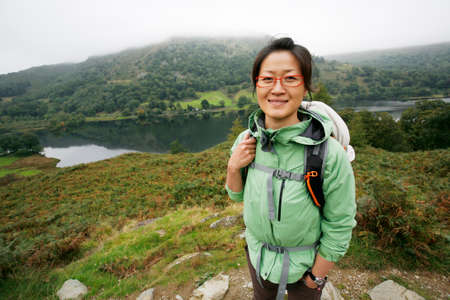 Smiling East Asian Woman hiking in Lake District, Cumbria, UK. Stock Photo - 24054129